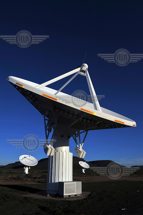 One of the dishes of the MeerKAT array (KAT-7), the largest and most sensitive radio telescope in the southern hemisphere, until the Square Kilometer Array (SKA) is completed on the site in 2024. These dishes are part of the presursor array, are fully functional and producing large amounts of data. Close to 100 scientists and engineers are working on the MeerKAT project. Based at the engineering office in Cape Town, and at universities and technology companies across South Africa and Africa, these researchers interact closely with SKA teams around the world. In collaboration with South African industry and universities, and collaborating with global institutions, the South African team has developed technologies and systems for the MeerKAT telescope, including innovative composite telescope dishes and cutting edge signal processing hardware and algorithms.