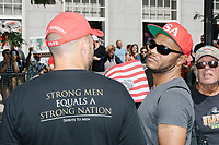 "Wearing a Trump 2020 ""Keep America Great"" hat and a Tribute to Men shirt, Ben Bergquam broadcasts for conservative media network ""America's Voice"" in the Straight Pride Parade in Boston, Massachusetts, on Sat., August 31, 2019. The parade was organized in reaction to LGBTQ Pride month activities by an organization called Super Happy Fun America. The Tribute to Men was a 2019 gathering outside the Conservative Political Action Committee (CPAC) meeting."