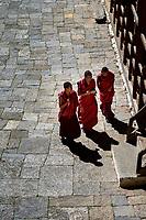 Buddhist monks in the courtyard of Trongsa Dzong, Bhutan