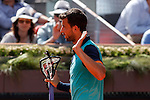 Grigor Dimitrov from Bulgary breaks his racket during his Madrid Open tennis tournament match against Rafa Nadal from Spain Republic in Madrid, Spain. May 08, 2015. (ALTERPHOTOS/Victor Blanco)