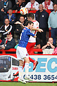 Greg Tansey of Stevenage wins a header from Liam Noble of Carlisle<br />  - Stevenage v Carlisle Untied - Sky Bet League 1 - Lamex Stadium, Stevenage - 21st September, 2013<br />  © Kevin Coleman 2013