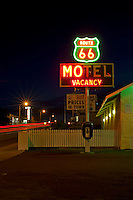 The neon sign of the motels and diners along Route 66 beckoned travelers.