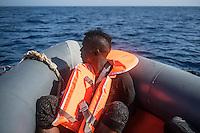 Sea Watch-2.<br /> Die Sea Watch-2 bei ihrer 13. SAR-Mission vor der libyschen Kueste.<br /> Im Bild: Ein gefluechteter ist von seinem Schlauchboot ins Wasser gesprungen und wurde von einem der Rettungsboote aufgenommen.<br /> 20.10.2016, Mediterranean Sea<br /> Copyright: Christian-Ditsch.de<br /> [Inhaltsveraendernde Manipulation des Fotos nur nach ausdruecklicher Genehmigung des Fotografen. Vereinbarungen ueber Abtretung von Persoenlichkeitsrechten/Model Release der abgebildeten Person/Personen liegen nicht vor. NO MODEL RELEASE! Nur fuer Redaktionelle Zwecke. Don't publish without copyright Christian-Ditsch.de, Veroeffentlichung nur mit Fotografennennung, sowie gegen Honorar, MwSt. und Beleg. Konto: I N G - D i B a, IBAN DE58500105175400192269, BIC INGDDEFFXXX, Kontakt: post@christian-ditsch.de<br /> Bei der Bearbeitung der Dateiinformationen darf die Urheberkennzeichnung in den EXIF- und  IPTC-Daten nicht entfernt werden, diese sind in digitalen Medien nach §95c UrhG rechtlich geschuetzt. Der Urhebervermerk wird gemaess §13 UrhG verlangt.]