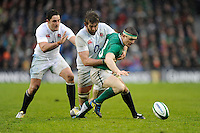 The ball goes loose as Brian O'Driscoll of Ireland is tackled by Geoff Parling of England as Brad Barritt of England looks on during the RBS 6 Nations match between Ireland and England at the Aviva Stadium, Dublin on Sunday 10 February 2013 (Photo by Rob Munro)