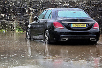 A  car stranded in the flood caused by heavy rain in Crickhowell, south Wales, UK. Saturday 26 October 2019