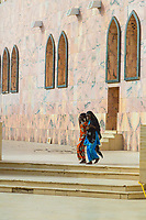 Senegal, Touba.  Two Senegalese Women Leaving the Grand Mosque.