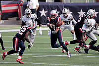 27th September 2020, Foxborough, New England, USA;  New England Patriots quarterback Cam Newton (1) pitches the ball to New England Patriots defensive back J.J. Taylor (42) during the game between the New England Patriots and the Las Vegas Raiders