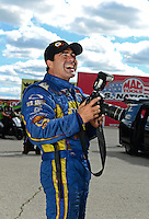 Sept 8, 2012; Clermont, IN, USA: NHRA funny car driver Ron Capps plays with a camera during qualifying for the US Nationals at Lucas Oil Raceway. Mandatory Credit: Mark J. Rebilas-