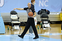 CHAPEL HILL, NC - FEBRUARY 24: Official Tommy Morrissey points to where the inbounds play should start during a game between Marquette and North Carolina at Dean E. Smith Center on February 24, 2021 in Chapel Hill, North Carolina.