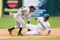 Second baseman Diogenes Luis (15) of the Princeton Rays applies a late tag as Jose Rivero (6) of the Pulaski Mariners steals second base at Calfee Field in Pulaski, VA, Sunday July 6, 2008. (Photo by Brian Westerholt / Four Seam Images)