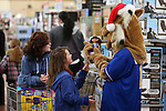 Willy the Wildcat helps one of nearly 170 elementary students shop as part of the Holiday with a Hero program at Walmart in Carson City, Nev., on Tuesday, Dec. 17, 2013. The community event partners military, firefighters, law enforcement and medical personnel with local Students in Transition to provide them with Christmas presents.<br /> Photo by Cathleen Allison