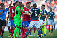 Orlando, Florida - Saturday, June 04, 2016: Costa Rican goalkeeper Patrick Pemberton (18) and Costa Rican defender Johnny Acosta (2) try to restrain Paraguayan defender Miguel Samudio (6) during a Group A Copa America Centenario match between Costa Rica and Paraguay at Camping World Stadium.