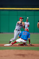 Florida Fire Frogs second baseman Alejandro Salazar (18) turns a double play as Jose Pujols (23) slides in during a game against the Clearwater Threshers on June 1, 2018 at Spectrum Field in Clearwater, Florida.  Clearwater defeated Florida 2-0 in a game that was started on May 19th but called in the fifth inning due to weather.  (Mike Janes/Four Seam Images)