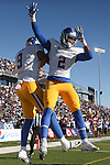 San Jose State wide receiver Tim Crawley (2) celebrates a touchdown against Nevada with teammate Justin Holmes (9) during the first half of an NCAA college football game in Reno, Nev., on Saturday, Nov. 14, 2015. (AP Photo/Cathleen Allison)