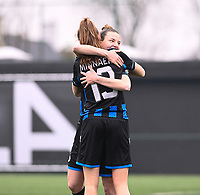 Marie Minnaert (13) of Club Brugge and Nicky Van Den Abbeele (28) of Club Brugge pictured hugging ahead of a female soccer game between Club Brugge Dames YLA and White Star Woluwe on the 12 th matchday of the 2020 - 2021 season of Belgian Scooore Womens Super League , saturday 30 January 2021  in Brugge , Belgium . PHOTO SPORTPIX.BE | SPP | DAVID CATRY