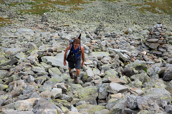 "Hiker ascending the Nelson Crag Trail over Felsenmeer barrens near the summit of Mount Washington in the White Mountains, New Hampshire. Felsenmeer barrens are found in the alpine zone of the Presidential Range. Felsenmeer is a German word meaning ""Sea Of Rocks""."
