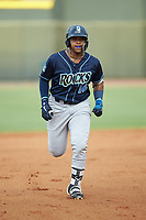 Dennicher Carrasco (16) of the Wilmington Blue Rocks rounds the bases after hitting a home run against the Winston-Salem Warthogs at BB&T Ballpark on July 17, 2019 in Winston-Salem, North Carolina. The Blue Rocks defeated the Warthogs 4-1. (Brian Westerholt/Four Seam Images)