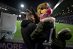 Home supporters behind one of the goals are greeted by the club mascot Baggie Bird before West Bromwich Albion take on Leeds United in a SkyBet Championship fixture at the Hawthorns. Formed in 1878, the home team were relegated from the English Premier League the previous season and were aiming to close the gap on the visitors at the top of the table. Albion won the match 4-1 watched by a near-capacity crowd of 25,661.