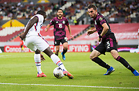 , MEXICO - : Benji Michel #14 of the United States attempts to move past  Manuel Mayorga #3 of Mexico during a game between  and undefined at  on ,  in , Mexico.