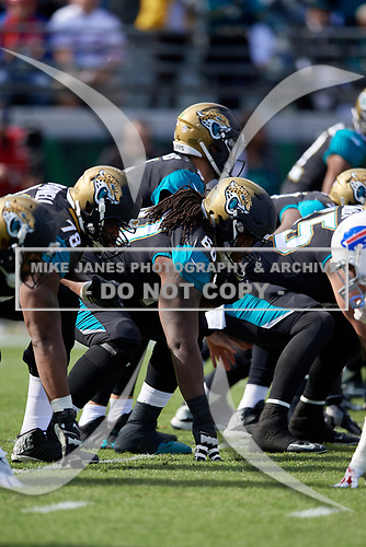 Jacksonville Jaguars guard A.J. Cann (60) lines up during an NFL Wild-Card football game against the Buffalo Bills, Sunday, January 7, 2018, in Jacksonville, Fla.  (Mike Janes Photography)