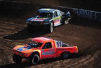 Dec. 10, 2011; Chandler, AZ, USA;  LOORRS pro 4 unlimited driver Adrian Cenni (11) leads Kyle Leduc during round 15 at Firebird International Raceway. Mandatory Credit: Mark J. Rebilas-