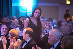 © Joel Goodman - 07973 332324 . 05/03/2015 .  Midland Hotel , Manchester , UK .Winner Lucie Alker of Eversheds LLP , walks to the stage to collect her award . Trainee of the Year . The Manchester Legal Awards 2015 . Photo credit : Joel Goodman