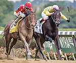 ELMONT, NY - OCTOBER 08: Manuel Franco, atop Yellow Agate #4, just beating out Irad Ortiz Jr., atop Libby's Tail #2, at the finish line, and winning the 69th Running of The Frizette, on Jockey Club Gold Cup Day at Belmont Park on October 8, 2016 in Elmont, New York. (Photo by Douglas DeFelice/Eclipse Sportswire/Getty Images)