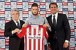 Atletico de Madrid's new player Yannick Carrasco (c) with the President Enrique Cerezo (l) and the General Manager Jose Luis Perez Caminero (r) during his official presentation. July 13, 2015. (ALTERPHOTOS/Acero)
