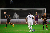 LAKE BUENA VISTA, FL - JULY 23: Cristian Pavon #10 of the LA Galaxy dribbles the ball during a game between Los Angeles Galaxy and Houston Dynamo at ESPN Wide World of Sports on July 23, 2020 in Lake Buena Vista, Florida.