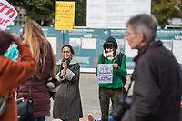 """Mit Plueschtieren als Symbol fuer eine angebliche """"pysiche und psychische Schaedigung unsere Kinder durch die Corona-Maßnahmen"""" protestierten Corona-Leugner und Impfgegner unter dem Motto """"Haende weg von unseren Kinder"""" am Montag den 19. Oktober 2020 in Berlin. Dabei wurden Schilder mit der Aufschrift """"Nur die Coronaregeln machen unsere Kinder krank"""" und """"Maske ist Folter"""" gehalten. Manche der Kuscheltiere hatten eine Maske mit dem Spruch """"I can't breath"""" der antirassistischen Blick Lives Matter-Bewegung um.<br /> Im Bild: Kundgebungsteilnehmerinnen mit Schildern """"Kindern die Luft zum Atmen nehmen ist ein Verbrechen!"""" (links) und  """"Ihr seid Verbrecher!!! Finger weg von unseren Kindern!!!"""" (rechts)<br /> 19.10.2020, Berlin<br /> Copyright: Christian-Ditsch.de"""