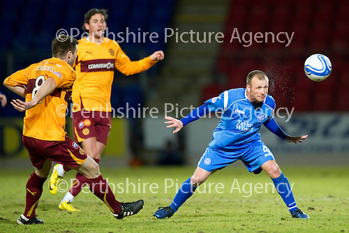 St Johnstone v Motherwell....26.01.11  .Jody Morris heads clear from Steven Jennnings.Picture by Graeme Hart..Copyright Perthshire Picture Agency.Tel: 01738 623350  Mobile: 07990 594431