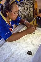 Yogyakarta, Java, Indonesia.  Woman Drawing Design on Pattern for Batiks.