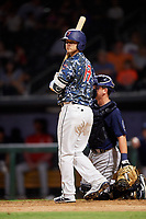 Jacksonville Jumbo Shrimp third baseman Brian Schales (13) at bat in front of catcher Michael Barash (16) during a game against the Mobile BayBears on April 14, 2018 at Baseball Grounds of Jacksonville in Jacksonville, Florida.  Mobile defeated Jacksonville 13-3.  (Mike Janes/Four Seam Images)