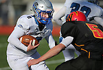 Whittell's Aubrey Felton pursues Pahranagat Valley quarterback Tabor Maxwell in the second half of the NIAA DIV championship game against Whittell High at Dayton High School in Dayton, Nev., on Saturday, Nov. 21, 2015. PVHS won 54-28. (Cathleen Allison/Las Vegas Review Journal)