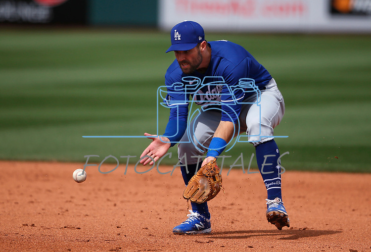 Chris Taylor makes a play during a spring training game between the Texas Rangers and Los Angeles Dodgers in Surprise, Ariz., on Sunday, March 7, 2021.<br /> Photo by Cathleen Allison