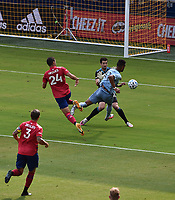 KANSAS CITY, KS - SEPTEMBER 19: Matt Hedges #24 and Jimmy Maurer #20 of FC Dallas try to stop Khiry Shelton #11 of Sporting Kansas City during a game between FC Dallas and Sporting Kansas City at Children's Mercy Park on September 19, 2020 in Kansas City, Kansas.