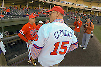 Clemson University President Jim Clements received his own jersey to throw out the first pitch for the Clemson Tigers in the Reedy River Rivalry game against the South Carolina Gamecocks on March 1, 2014, at Fluor Field at the West End in Greenville, South Carolina. South Carolina won, 10-2. (Tom Priddy/Four Seam Images)