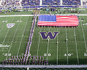 SEATTLE, WA - August 31:  Washington band members held the American Flag on the field during the playing of the national anthem before the college football game between the Washington Huskies and the Eastern Washington Eagles on August 31, 2019 at Husky Stadium in Seattle, WA. Jesse Beals/www.Olympicphotogroup.com
