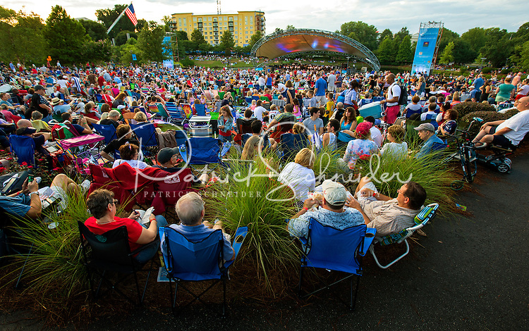 The Charlotte Symphony 2015 Summer Pops season outdoor concerts at Symphony Park, in Charlotte's SouthPark Mall area has continued as a beloved Charlotte tradition since 1983. Symphony Park is located behind SouthPark mall at 4400 Sharon Road, Charlotte, NC.   The Charlotte Symphony Orchestra is one of the largest and most-active professional performing arts organizations in the Carolinas. Contact Patrick Schneider Photography to see other photographs of Charlotte NC lifestyle<br /> <br /> Charlotte Photographer - PatrickSchneiderPhoto.com
