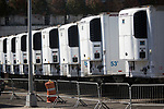 Refrigerated trailers make up a temporary morgue near the Office of Chief Medical Examiner during the coronavirus pandemic on April 6, 2020 in New York City.  More than 10,000 people have died from COVID-19 in the U.S..  Photograph by Michael Nagle