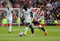 Pictured L-R: Nathan Dyer of Swansea challenged by Jack Colback of Sunderland. Sunday 11 May 2014<br /> Re: Barclay's Premier League, Sunderland v Swansea City FC at the Stadium of Light, Sunderland, UK.