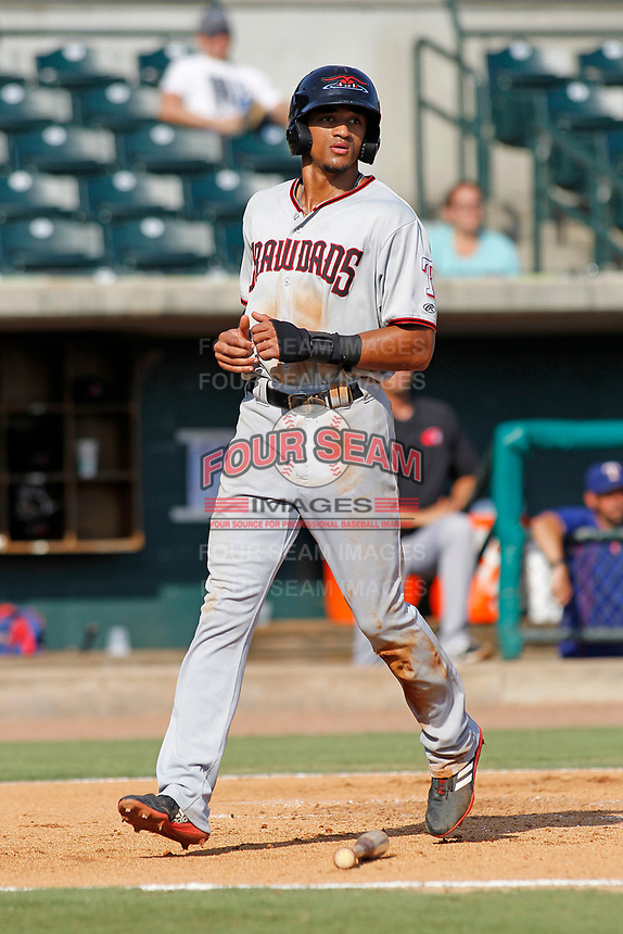 Hickory Crawdads outfielder Bubba Thompson (25) scoring a run  during a game against the Charleston Riverdogs at the Joseph P. Riley Ballpark in Charleston, South Carolina.  Hickory defeated Charleston 8-7. (Robert Gurganus/Four Seam Images)