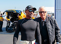 Feb 7, 2020; Pomona, CA, USA; NHRA top fuel driver Antron Brown (left) with producer/TV personality Barry Weiss during qualifying for the Winternationals at Auto Club Raceway at Pomona. Mandatory Credit: Mark J. Rebilas-USA TODAY Sports