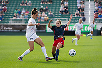 CARY, NC - APRIL 10: Havana Solaun #19 of the NC Courage passes the ball past a lunging Ashley Sanchez #10 of the Washington Spirit during a game between Washington Spirit and North Carolina Courage at Sahlen's Stadium at WakeMed Soccer Park on April 10, 2021 in Cary, North Carolina.