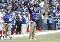27 Nov 2005:   New York Giants head coach Tom Coughlin raised his arms up in the air in frustration after his offense of unit was flagged for back to back false starts against the Seattle Seahawks during the second quarter at Quest Field in Seattle, WA.