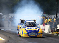 Aug 15, 2014; Brainerd, MN, USA; NHRA funny car driver Ron Capps during qualifying for the Lucas Oil Nationals at Brainerd International Raceway. Mandatory Credit: Mark J. Rebilas-