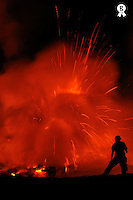 Woman watching lava eruption on crater edge (Licence this image exclusively with Getty: http://www.gettyimages.com/detail/84869032 )