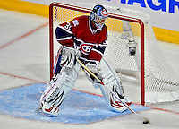 22 April 2009: Montreal Canadiens goaltender Carey Price controls the puck in his crease against the Boston Bruins at the Bell Centre in Montreal, Quebec, Canada. The Bruins advanced to the Eastern Semi-Finals, eliminating the Canadiens from Stanley Cup competition with a 4-1 win and series sweep. ***** Editorial Sales Only ***** Mandatory Credit: Ed Wolfstein Photo
