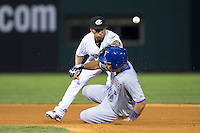 Charlotte Knights shortstop Leury Garcia (24) reaches for a throw as Luke Maile (26) of the Durham Bulls slides into second base at BB&T BallPark on July 22, 2015 in Charlotte, North Carolina.  The Knights defeated the Bulls 6-4.  (Brian Westerholt/Four Seam Images)