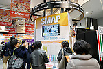 Fans take pictures of an exhibit space for the SMAP's new album SMAP 25 YEARS at the Tsutaya store in Shibuya on December 22, Tokyo, Japan. Japan's most popular boy band announced that they would split by the end of the year, and the special album includes 50 of the band's songs as selected by fans. (Photo by Rodrigo Reyes Marin/AFLO)